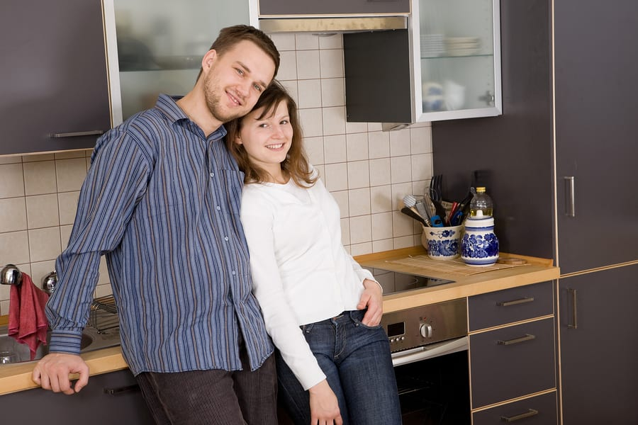 Couple in renovated kitchen